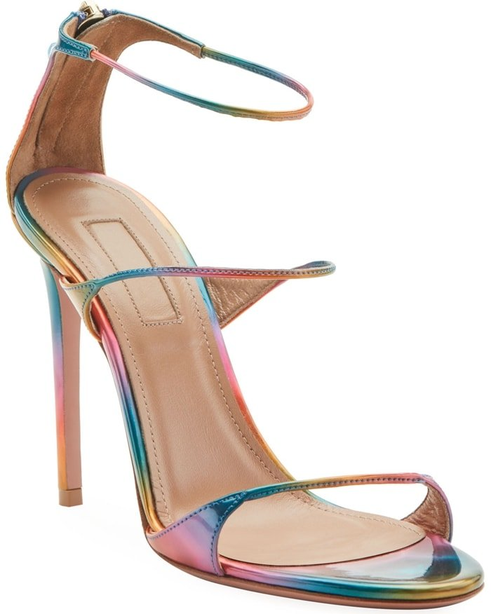 Crafted in Italy from a sleek disco rainbow print, this open-toed pair features a slender strap across the foot and around the ankle