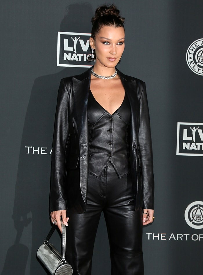 Bella Hadid channels Catwoman in Tommy x Zendaya three-piece leather suit