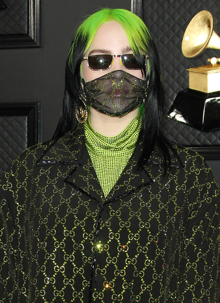Billie Eilish conceals her face with a crystal-embellished Gucci face mask and sunnies