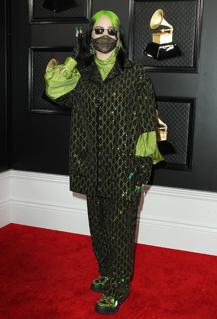 Billie Eilish wears head-to-toe Gucci in black and neon green
