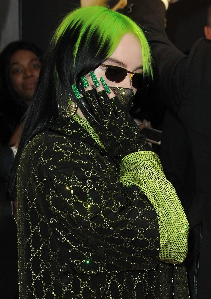 Billie Eilish has her nails painted in Gucci monogram