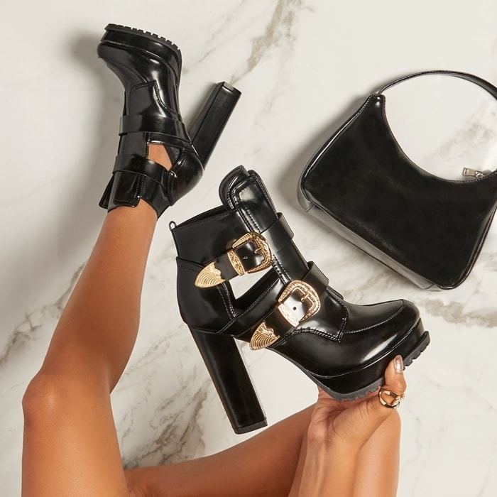 A platform bootie featuring an ultra-high block heel, side cutouts, lug sole, and large adjustable buckles