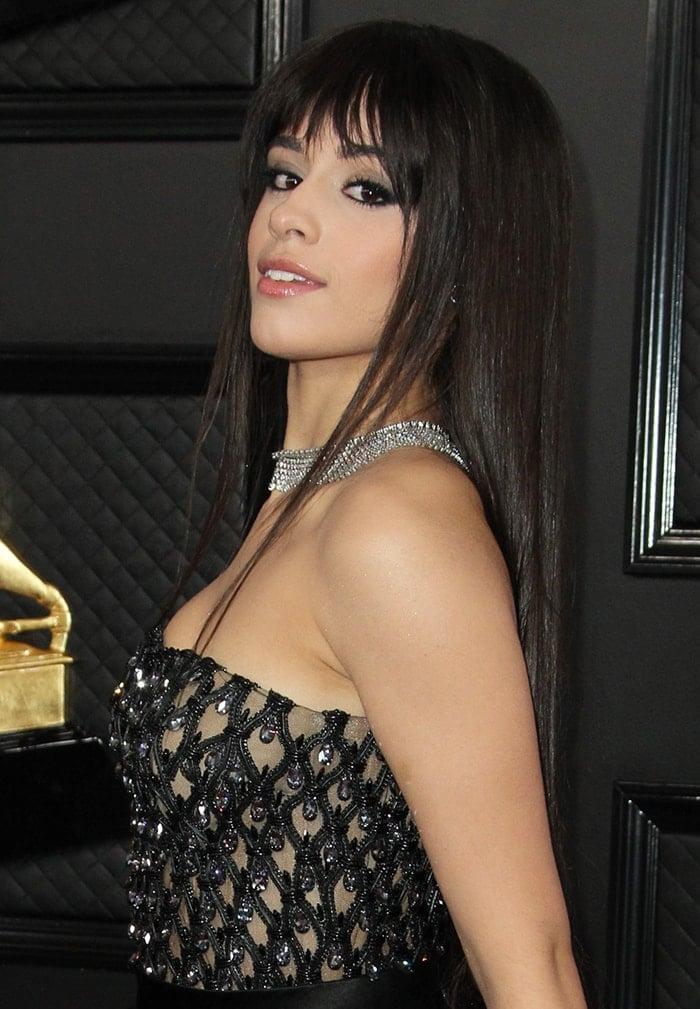 Camila Cabello wears sleek straightened locks with fringe and smoky eye-makeup