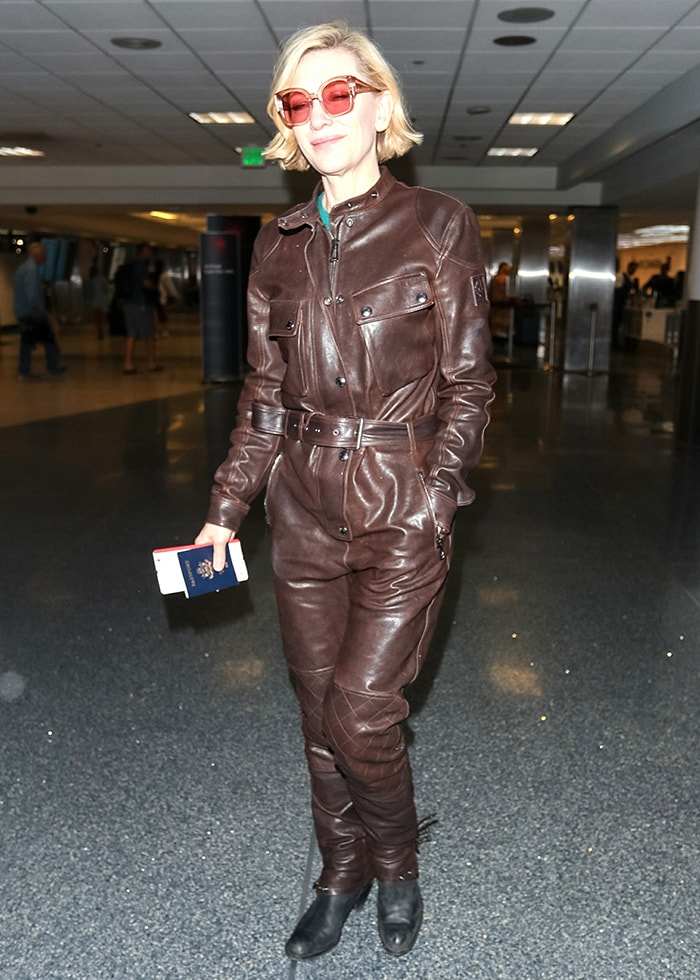 Cate Blanchett strolls through LAX terminal in a brown leather boiler suit