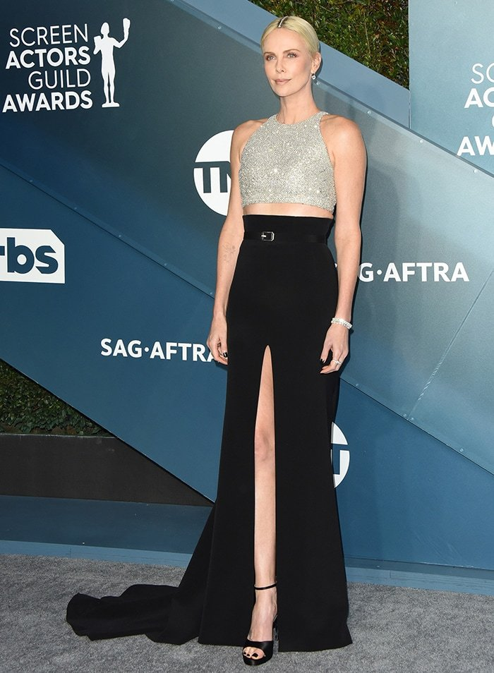 Charlize Theron showcases her midriff, arms and legs in a custom Givenchy ensemble