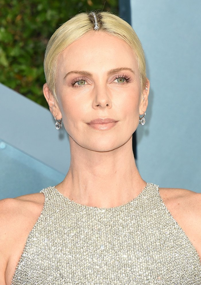 Charlize Theron wears Tiffany & Co. bracelet as a hair accessory to cover her roots
