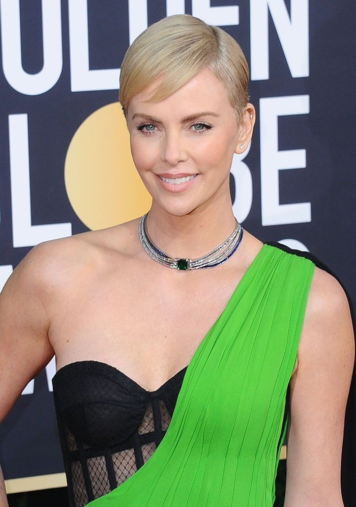 Charlize Theron teams her gown with Tiffany and Co. jewels