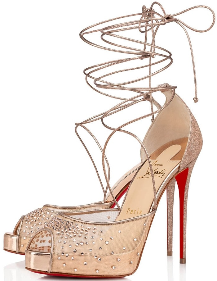 Set atop a concealed platform, these sky-high crystal-embellished stilettos feature a delicate wraparound ankle strap