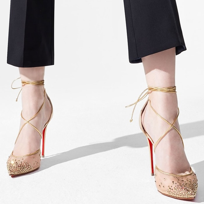 Styling a d'Orsay silhouette, tiny glass crystals lightly frost the Rete upper showcasing glimpses of skin while the seductive 100mm gold Specchio Brosse leather stiletto heel yields an impossibly long leg line