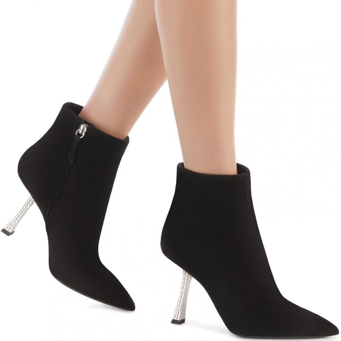 These black, suede ankle boots are characterized by their tapered design and by their sculpted heel, covered in crystals
