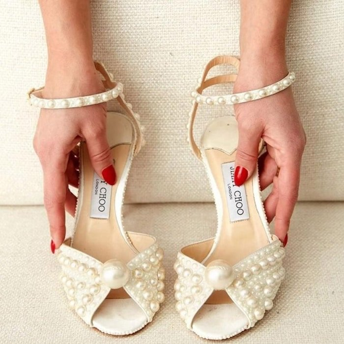 Sacora is a vintage inspired sandal crafted in sophisticated white satin with all over pearls