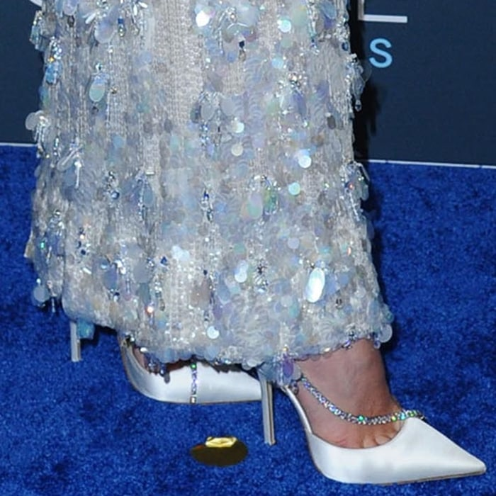 Florence Pugh showed off her feet in white satin Jimmy Choo Talika pumps