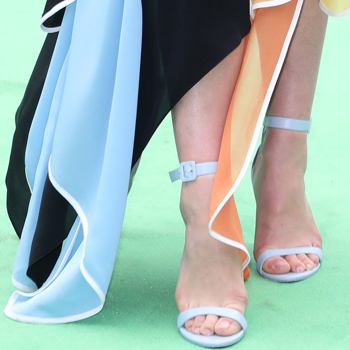 Florence Pugh's toes getting squeezed in her light blue sandals