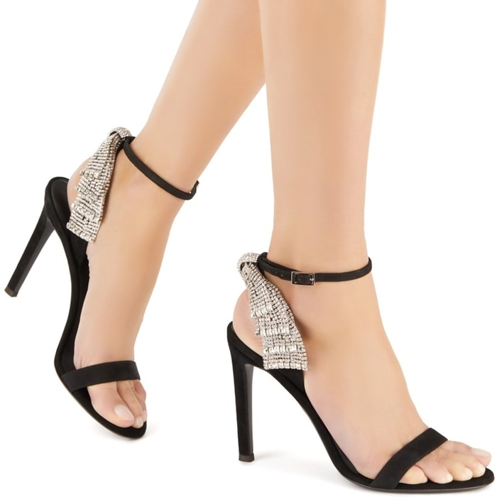 These high-heel, black suede sandals are embellished by the vintage Bow jewel on the ankle strap