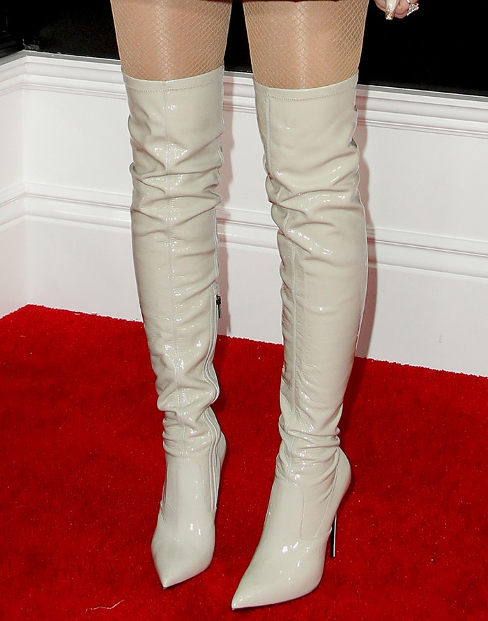 Gwen Stefani adds a touch of edge to her look with latex over-the-knee boots