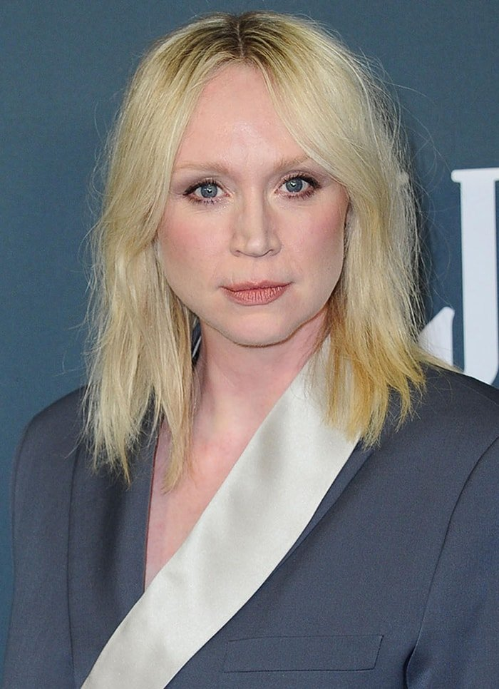 Gwendoline Christie wears a messy hairstyle with barely there makeup