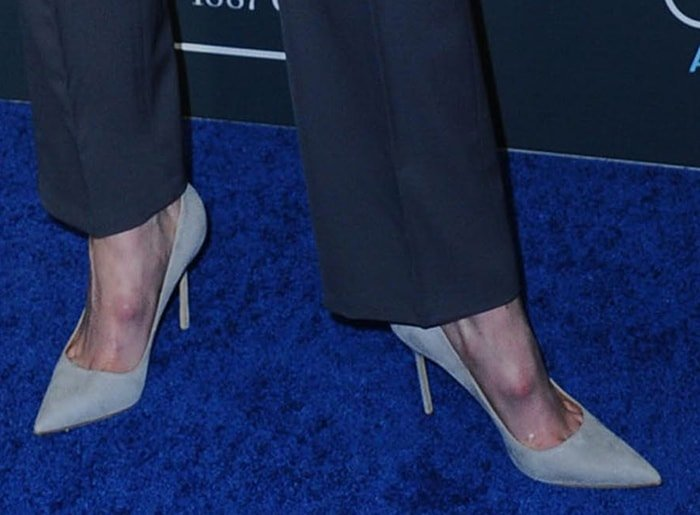 Gwendoline Christie reveals her bone spurs in gray suede pumps