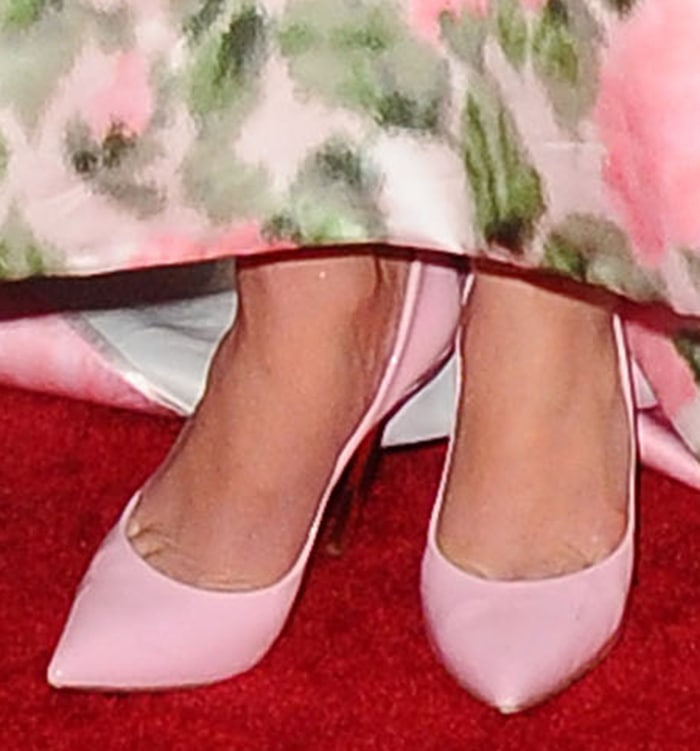 Jennifer Lopez pairs her ladylike gown with pastel pink pumps