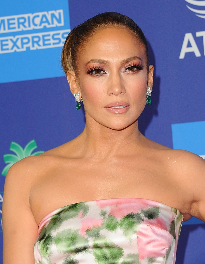 Jennifer Lopez wears her hair in a bun with pink eye-makeup and nude lip shade