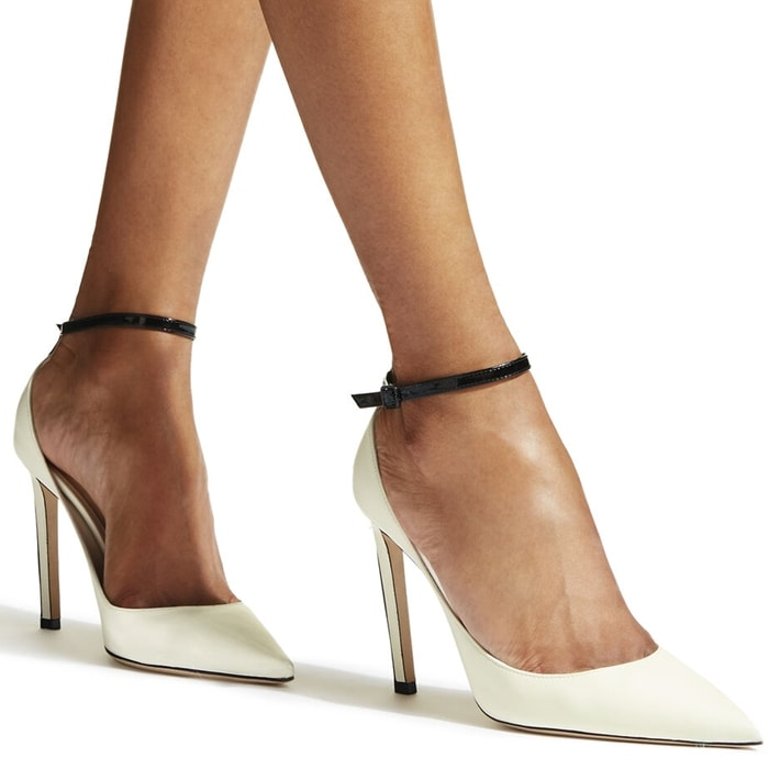 Designed in latte nappa and black patent leather to accentuate the silhouette of the foot, Helix features a contrasting back strip, ankle strap fastening and closed pointed toe