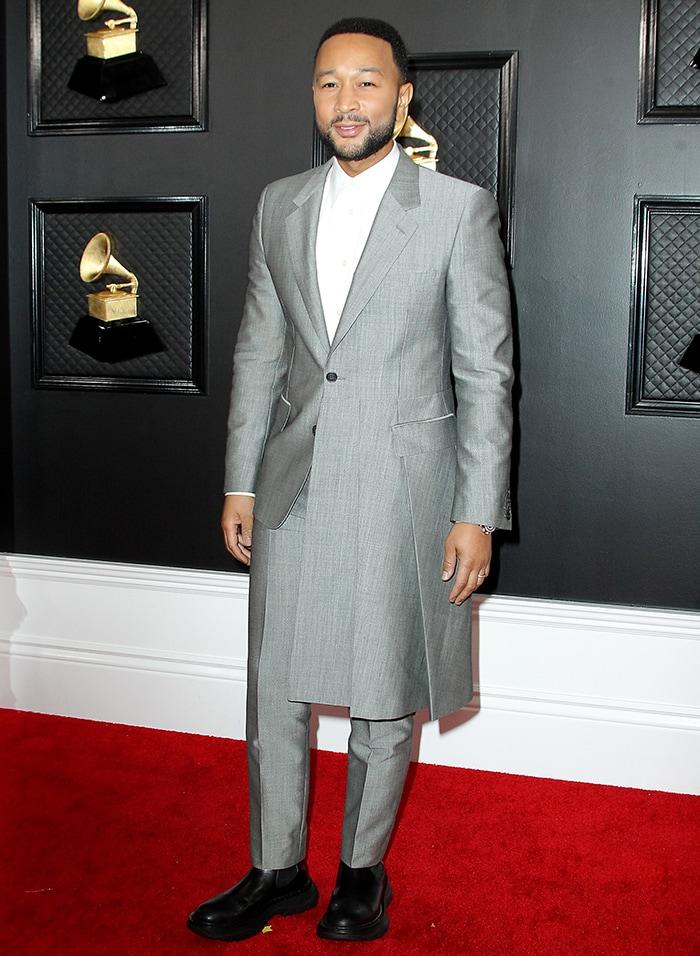John Legend wears asymmetric Alexander McQueen gray suit