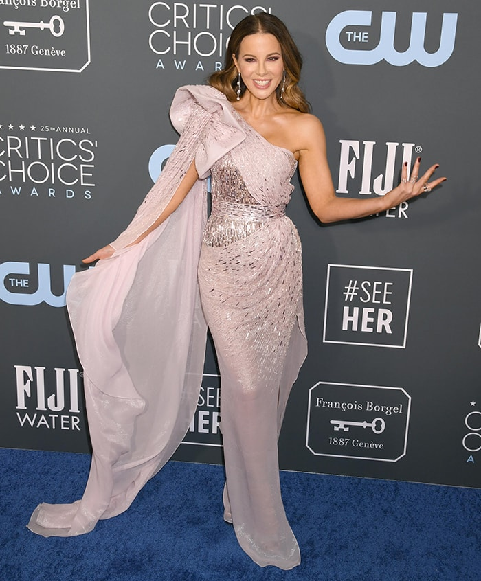 Kate Beckinsale shows off her svelte figure in a Julien Macdonald gown