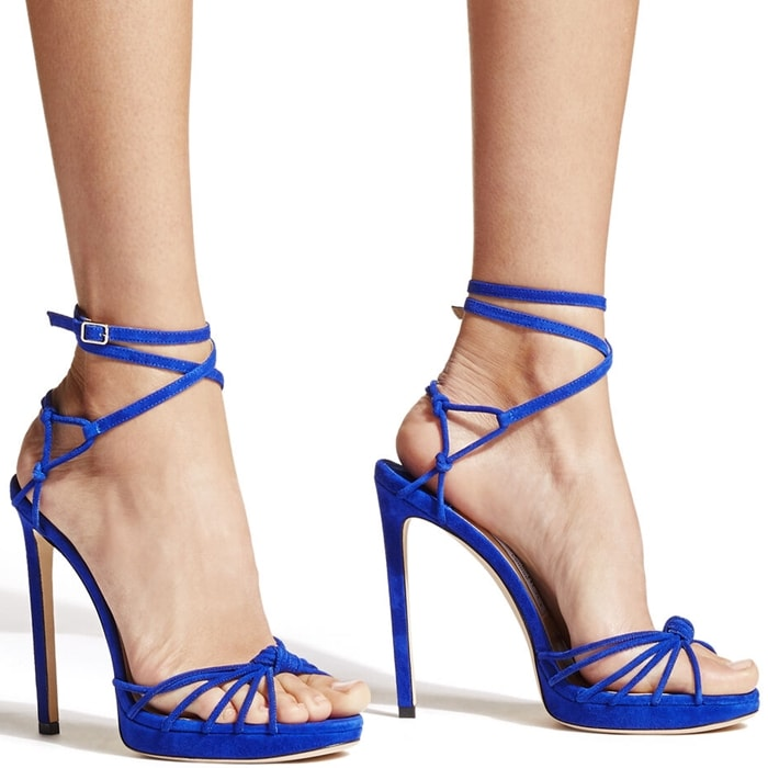 These cobalt blue sandals are set on a slender stiletto heel and platform, and designed with a knotted strappy front that elegantly encases your feet