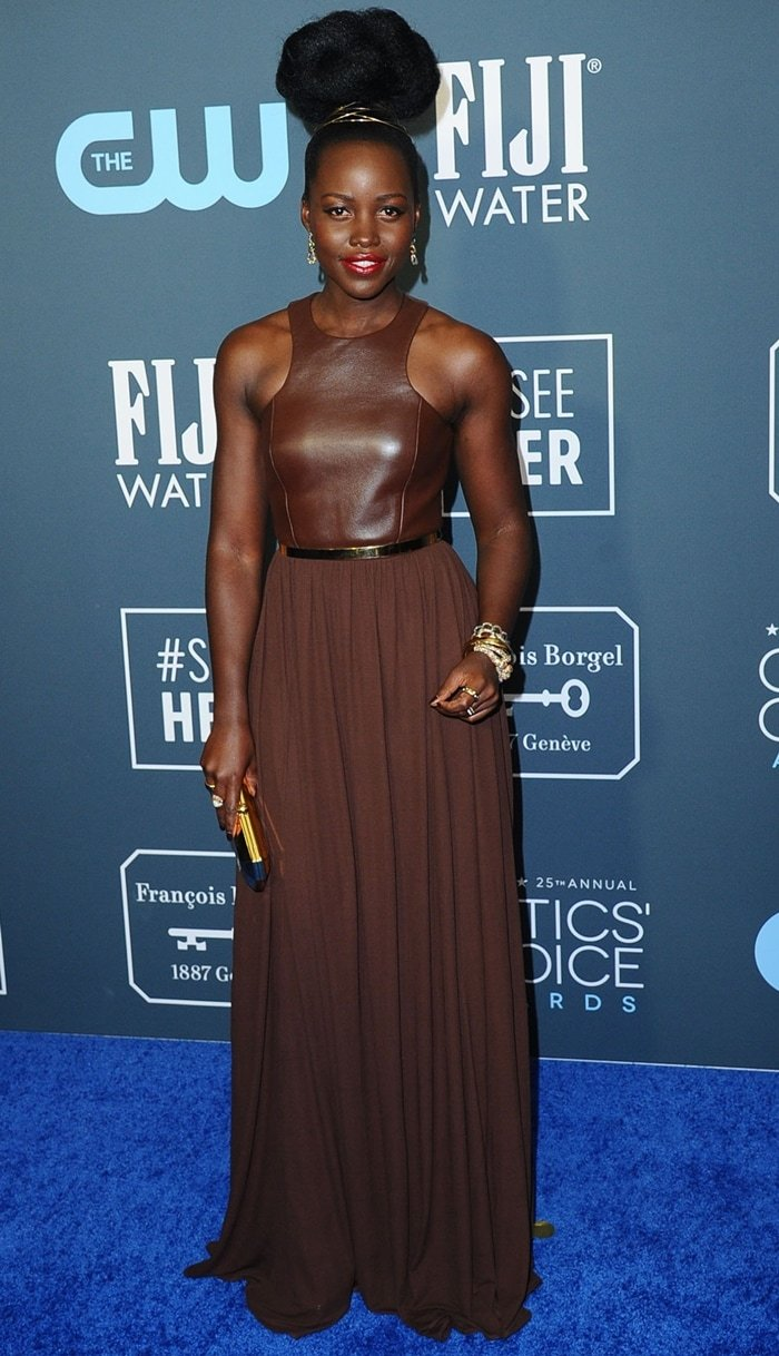 Lupita Nyong'o wearing a Michael Kors Collection chocolate plongé leather-and-georgette dress