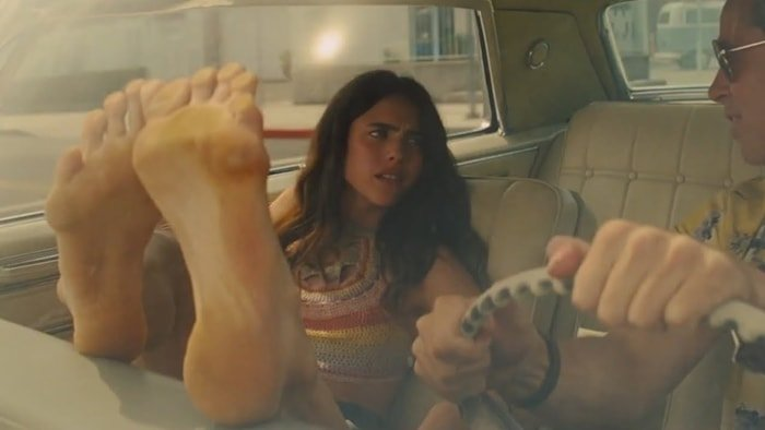 Margaret Qualley's feet against the windshield in Once upon a time in Hollywood