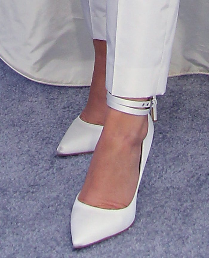 Millie Bobby Brown completes her head-to-toe white look with Louis Vuitton pumps