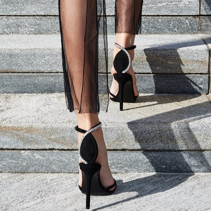 These high-heel, black suede sandals with ankle strap are embellished by applied decorative rhinestones
