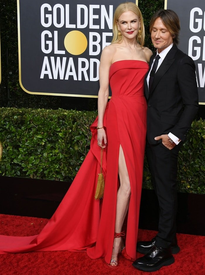 Nicole Kidman donned a strapless red column gown and her husband Keith Urban rocked a dapper black tuxedo