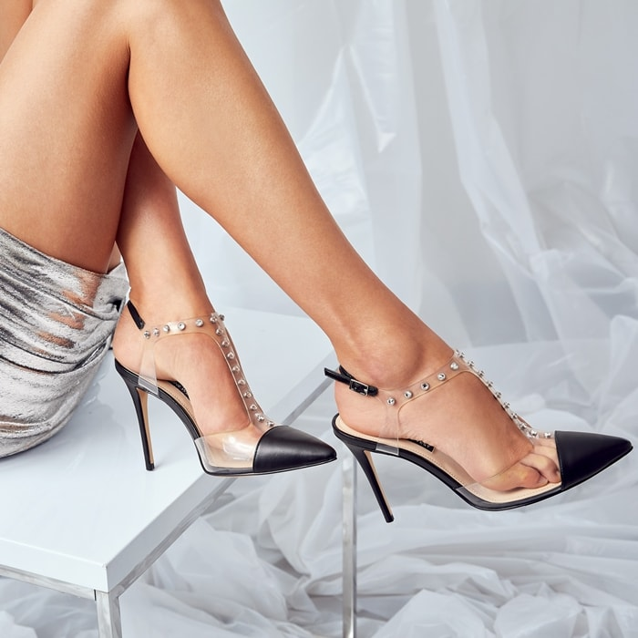 Nine West's Galena stilettos bring daring polish to dressy looks in rhinestone-studded translucent straps and a chic pointed toe