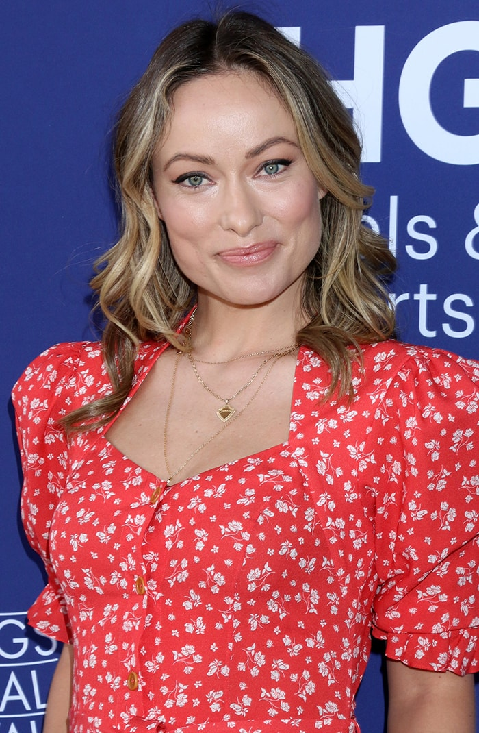 Olivia Wilde wears minimal makeup with dusty rose lip shade and blush