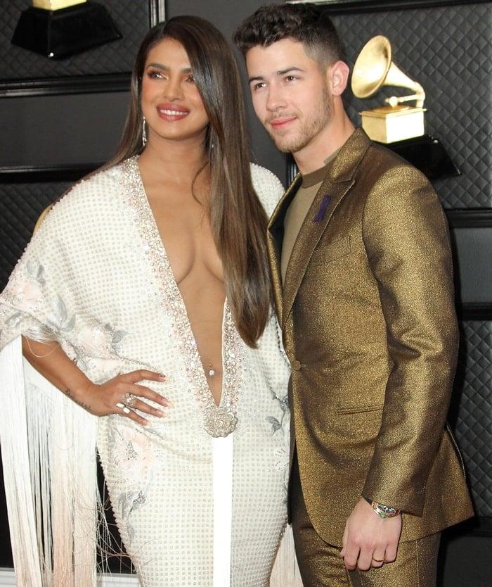 Nick Jonas rocked an Ermenegildo Zegna XXX tuxedo while Priyanka Chopra flaunted her belly button ring