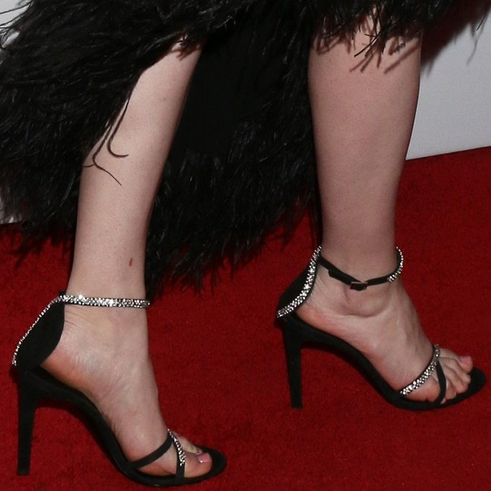 Rachel Brosnahan's hot feet in black suede Miria rhinestone-embellished sandals from Giuseppe Zanotti