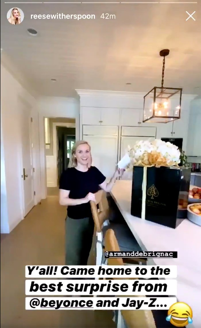 Reese Witherspoon receives a case of Armand de Brignac champagne from Beyonce and Jay-Z