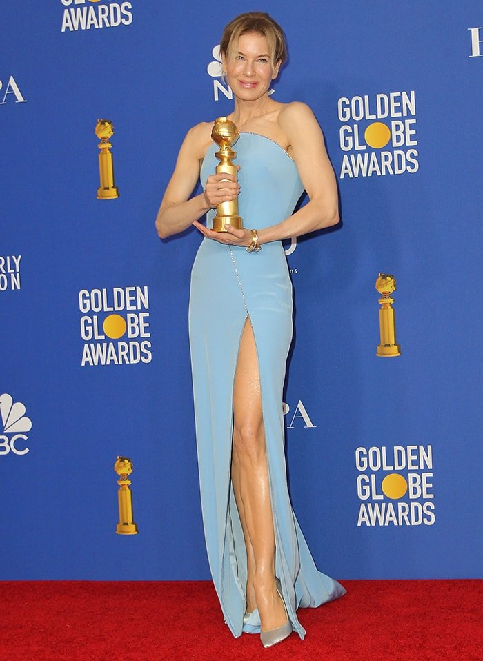 Renee Zellweger shows off her slender legs in Armani Prive pastel blue gown