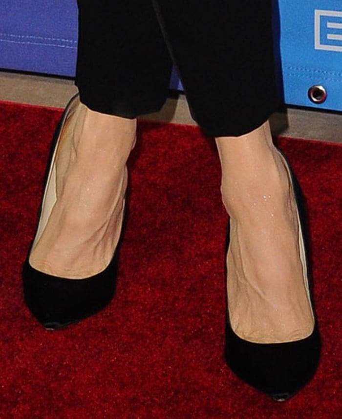 Renee Zellweger completes her head-to-toe black look with Jimmy Choo pumps