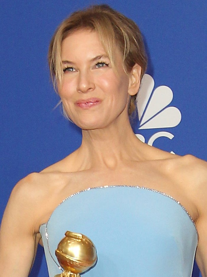 Renee Zellweger highlights her natural beauty with minimal makeup and messy updo