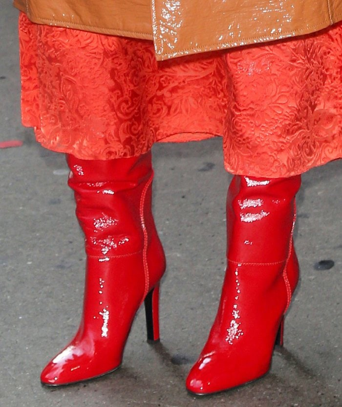 Rose Byrne pairs her vibrant outfit with shiny red leather knee-high boots