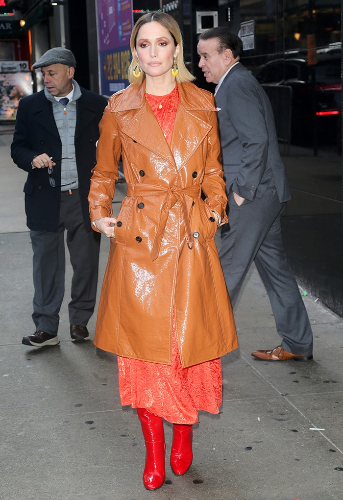 Rose Byrne slips into an orange dress layered with Veronica Beard knee-high red boots