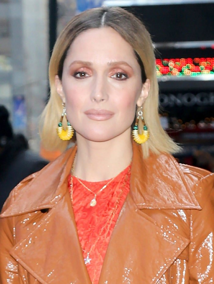 Rose Byrne wears complementing eye-makeup with yellow earrings