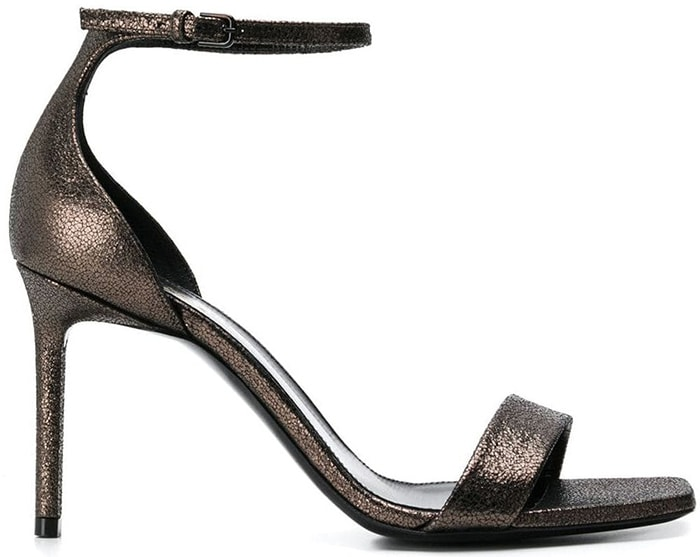 Expertly crafted in Italy from luxurious leather, these metallic Amber sandals from Saint Laurent feature a square toe, a strappy design, an ankle strap with a side buckle fastening, a branded insole and a high stiletto heel