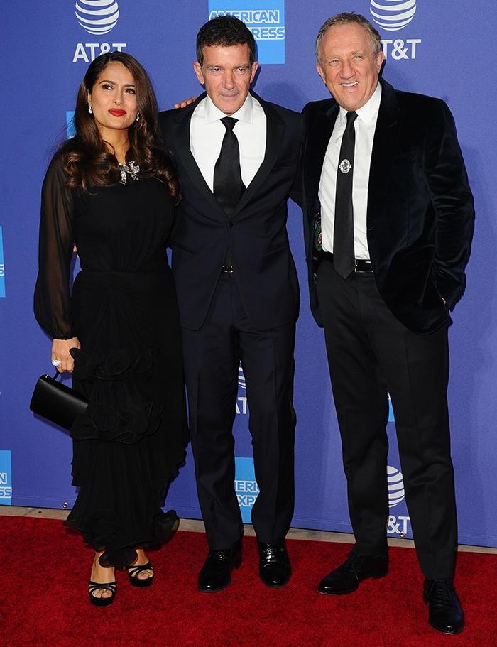Salma Hayek, Antonio Banderas and Francois-Henri Pinault pose together at the 2020 Palm Springs International Film Festival gala