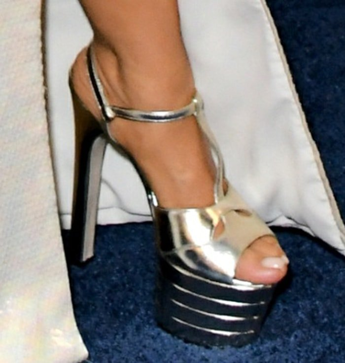 Salma Hayek adds few inches to her height with Gucci platform sandals