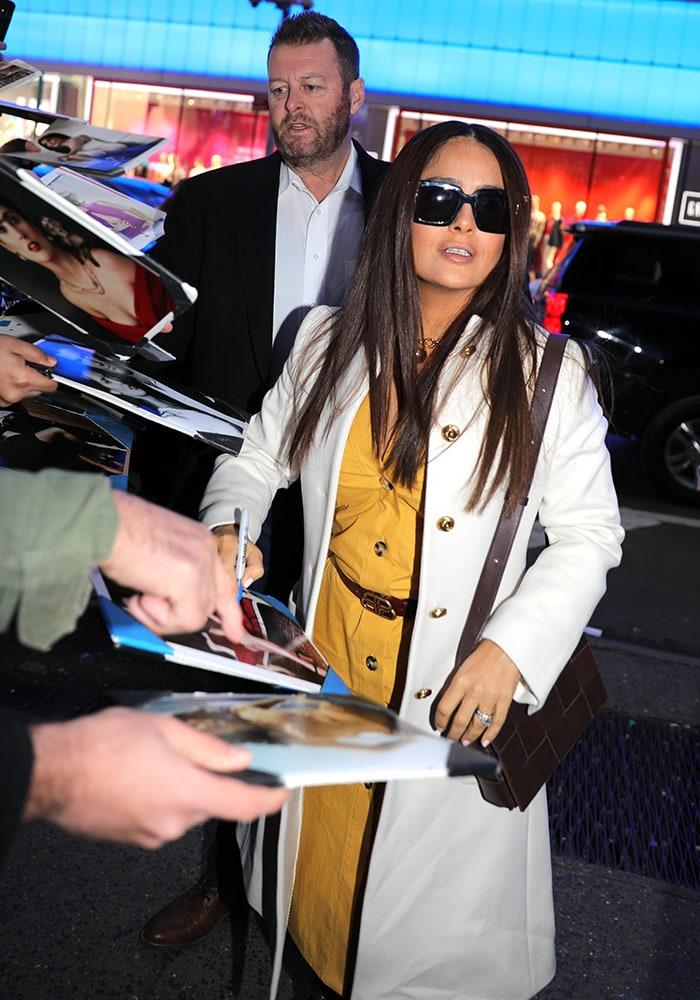 Salma Hayek signs autographs outside Good Morning America studio in New York City