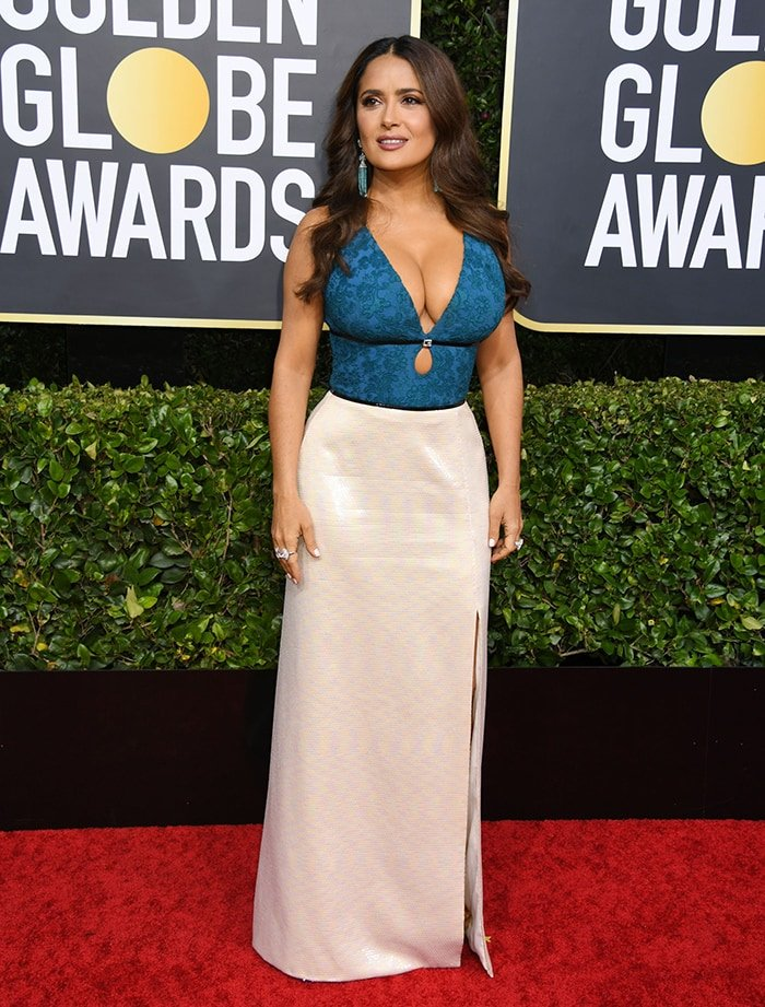 Salma Hayek shows plenty of cleavage in a Gucci gown