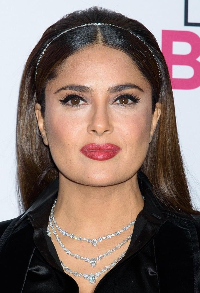 Salma Hayek wears a diamond headband and a layered diamond necklace