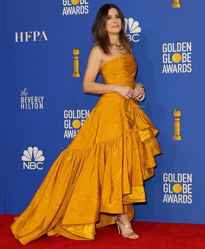 Sandra Bullock skipped the red carpet arrival but posed for photos in the press room following the ceremony